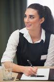 Happy businesswoman looking up — Stock Photo