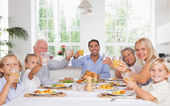 Happy family toasting at thanksgiving dinner — Foto de Stock