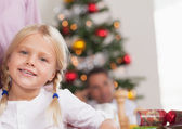 Cute girl smiling at christmas — Stock Photo
