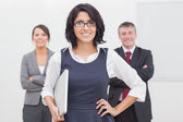 Smiling businesswoman and her team — Foto de Stock