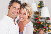 Couple embracing at christmas — Stock Photo