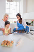 Girl looking at home-made cookies — Stock Photo