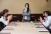 Businesswoman being applauded by peers — Stock Photo