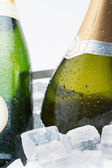 Two bottles of champagne chilling on ice — Stock Photo