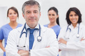Doctor and his team smiling — Stock Photo