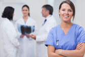 Nurse smiling with her team taking x-ray seriously — Stock Photo