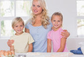 Blonde family smiling at the camera — Stock Photo