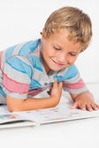 Happy boy reading a storybook — Stock Photo