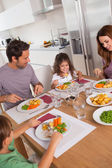 Family eating healthy dinner — Stock Photo