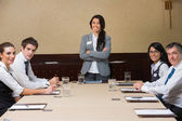 Smiling woman at head of business meeting — Stock Photo