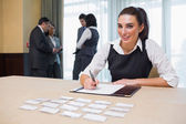 Smiling woman at welcome desk — Stock Photo