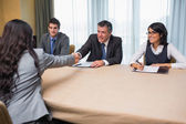 Interviewee shaking hands with panel member — Stock Photo