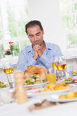 Man saying grace before dinner — Stock Photo