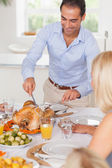 Man standing to carve the turkey — Stock Photo