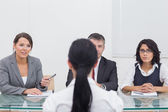 Three business folding hands in small meeting — Stock Photo