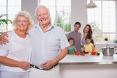 Grandparents in front of their family — Stock Photo