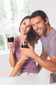 Smiling couple at the camera — Stock Photo