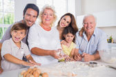 Smiling family baking together — Stock Photo