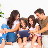 Pretty family using a digital tablet — Stock Photo