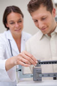 Medical scale getting adjusted — Stock Photo