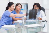 Nurse and doctor looking at x-ray — Stock Photo