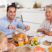 Man carving the thanksgiving turkey — Stock Photo