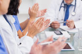 Nurses clapping a doctor — Stock Photo