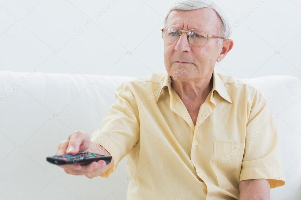 Elderly Using Elderly Man Using The Remote