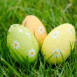 Stock Photo: Three easter eggs in the grass