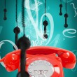 Retro phone with hanging receivers — Stock Photo