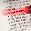 Royalty-Free Stock Photo: Investment definition highlighted in red