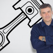 Mature mechanic standing next to car symbol — Stock Photo