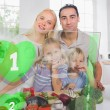 Happy family using interface to prepare dinner - Stockfoto