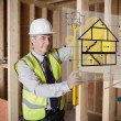 Architect using spirit level and looking at hologram interface — Stock Photo