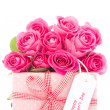 Bouquet of beautiful pink roses next to a pink gift with a happy — Stock Photo #24146499