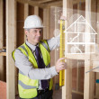 Architect using spirit level and looking at white hologram inter — Stock Photo