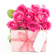 Bouquet of beautiful pink roses next to a pink gift with an empt — Stock Photo #24146611