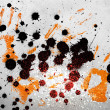 Orange hand prints with ink blots - Stock Photo