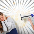 Girl shouting at her friend through megaphone — Stock Photo
