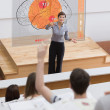 Teacher in front of futuristic interface pointing student  — Stock Photo