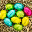 Easter eggs grouped together on straw - Stock Photo