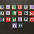 Alphabet blocks on blackboard — Stock Photo