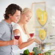 Couple making dinner using interface instructions — Stock Photo #24147599