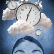 Woman looking up at alarm clock in clouds — Stock Photo