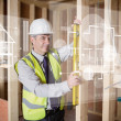 Stock Photo: Architect using spirit level while looking at white hologram int