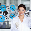 Serious chemist working with cell interface — Stock Photo