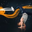Break dancer showing his agility and balance — Stock Photo