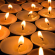 Many candles burning — Stock Photo