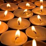 Many candles burning — Stock Photo