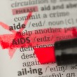 AIDS definition marked and highlighted in red — Stock Photo
